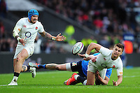 Henry Slade of England offloads the ball to team-mate Jack Nowell after being tackled to ground. RBS Six Nations match between England and Italy on February 26, 2017 at Twickenham Stadium in London, England. Photo by: Patrick Khachfe / Onside Images