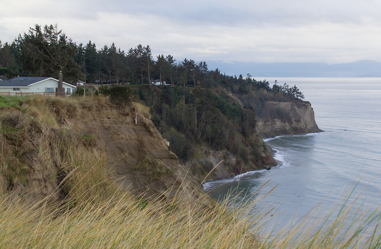 Whidbey Island, waterfront houses at risk, bluffs, beach cliffs, erosion, Puget Sound, Strait of Juan de Fuca, Washington State, Salish Sea, Pacific Northwest, Global Warming, sea level rise,