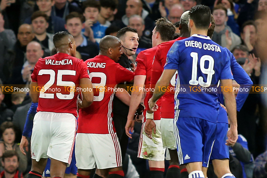 Manchester United players show their anger after Ander Herrera was shown a red card by referee, Michael Oliver during Chelsea vs Manchester United, Emirates FA Cup Football at Stamford Bridge on 13th March 2017