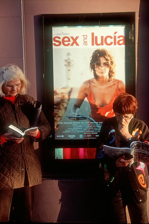 Seattle, Seattle International Film Festival, Women reading beside poster before film, Egyptian Theater, Capitol Hill,