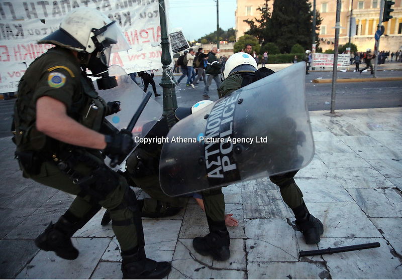 Pictured: A protester is braught down by riot police Sunday 09 May 2016<br /> Re: Riots break out between protesters and police in Syntagma Square, while MPs in the Greek Parliament vote for new tax, pension and welfare reforms in Athens, Greece