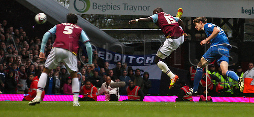 09.04.2012. East London, England. Serbian international striker Nikola ZIGIC of Birmingham City heads goalwards as Senegalese international Abdoulaye FAYE of West Ham United attempts to block during the npower Championship match between West Ham United and Birmingham City at Upton Park.  Final score: West Ham United 3-3 Birmingham City.