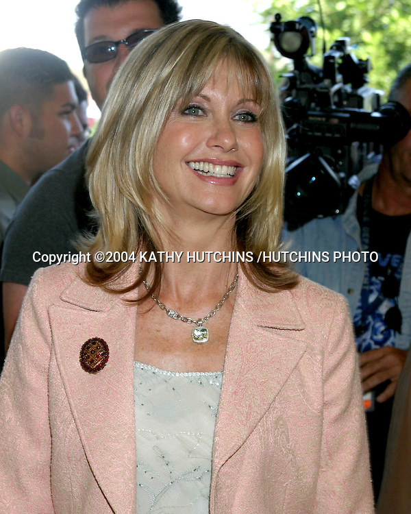 "©2004 KATHY HUTCHINS /HUTCHINS PHOTO.PERSONAL APPEARANCE BY OLIVIA NEWTON-JOHN.IN HONOR OF BREAST CANCER AWARENESS POSTAGE STAMP AND THE BREAST EXAM ""LIV KIT"" .SAVE-ON DRUG STORE.BURBANK, CA.OCTOBER 7, 2004..OLIVIA NEWTON-JOHN"