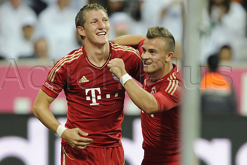25.09.2012. Munich, Germany. FC Bayern Munich versus Wolfsburg in the Alliance Arena Munich. Bastian Schweinsteiger celebates afetr scoring for Bayern Munich