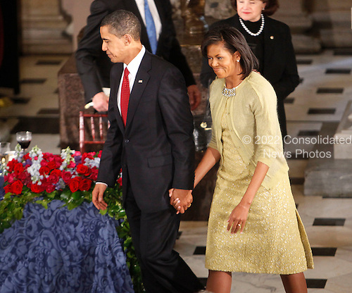 Washington, DC - January 20, 2009 -- United States President Barack Obama with first lady Michelle Obama at the end of their luncheon at Statuary Hall in the U.S. Capitol  in Washington, Tuesday, January 20, 2009. .Credit: Lawrence Jackson - Pool via CNP