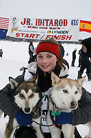 "Sunday February 28, 2010   Merissa Osmar poses with her lead dogs ""Polly"" (L) and ""Pepsi"" (Ri) at the finish line shortly after winning the 2010 Junior Iditarod Sled Dog Race . Willow , AK"