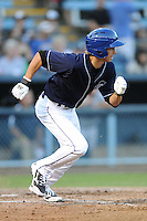 Asheville Tourists center fielder Max White #4 runs to first during a game against the Rome Braves  at McCormick Field on May 23, 2013 in Asheville, North Carolina. The Braves won the game 6-1. (Tony Farlow/Four Seam Images).