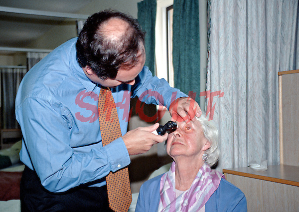 A consultant surgeon checking the eye of a patient who has just undergone cataract surgery. This image may only be used to portray the subject in a positive manner..©shoutpictures.com..john@shoutpictures.com
