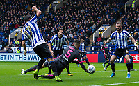 Leeds United's Ben White (centre) competing with Sheffield Wednesday's Atdhe Nuhiu (left) in the penalty area<br /> <br /> Photographer Andrew Kearns/CameraSport<br /> <br /> The EFL Sky Bet Championship - Sheffield Wednesday v Leeds United - Saturday 26th October 2019 - Hillsborough - Sheffield<br /> <br /> World Copyright © 2019 CameraSport. All rights reserved. 43 Linden Ave. Countesthorpe. Leicester. England. LE8 5PG - Tel: +44 (0) 116 277 4147 - admin@camerasport.com - www.camerasport.com
