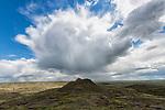 Great cloudburst of rain over a small hill in Grasslands National Park, Saskatchewan.