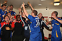 Stevenage players celebrate winning promotion in the changing room after the Blue Square Premier match between Kidderminster Harriers and Stevenage Borough at the Aggborough Stadium, Kidderminster on Saturday 17th April, 2010..© Kevin Coleman 2010