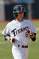 Richy Pedroza #6 of the Cal State Fullerton Titans runs to first base against the TCU Horned Frogs at Goodwin Field on February 26, 2012 in Fullerton,California. Fullerton defeated TCU 11-10.(Larry Goren/Four Seam Images)