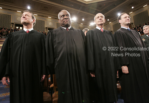 United States Supreme Court Justices attend US President George W. Bush's fifth State of the Union speech, Tuesday, Jan. 31, 2006, on Capitol Hill in Washington. Left to right are Chief Justice of the United States John G. Roberts, Jr., Associate Justice of the Supreme Court Clarence Thomas, Associate Justice of the Supreme Court Stephen G. Breyer, and Associate Justice of the Supreme Court Samuel A. Alito, Jr.<br /> Credit: Pablo Martinez Monsivais / Pool via CNP