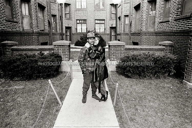 1992--Chicago, USA.Ricky and his girlfriend outside his apartment complex in Uptown...All photographs ©2003 Stuart Isett.All rights reserved.This image may not be reproduced without expressed written permission from Stuart Isett.