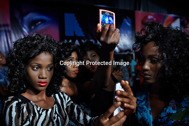 LAGOS, NIGERIA - OCTOBER 26: Models photograph themselves backstage at Lagos Fashion & Design Week on October 26, 2013 in Lagos, Nigeria. The early event gathers local designers and designers to show their latest collections. (Photo by: Per-Anders Pettersson)
