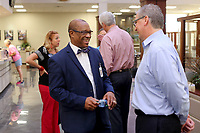 NWA Arkansas Democrat-Gazette/DAVID GOTTSCHALK John L. Colbert, superintendent of Fayetteville Public Schools, (left) visits Wednesday, September 12, 2018, with Craig Shy, loan manager at Arvest Bank, during a public morning reception at the bank in downtown Fayetteville. The morning reception offered the public a chance to recognize, visit with and listen to the new superintendent.
