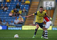 Josh Ruffels of Oxford United in action on his 100th appearance for the club during the The Checkatrade Trophy match between Oxford United and Exeter City at the Kassam Stadium, Oxford, England on 30 August 2016. Photo by Andy Rowland / PRiME Media Images.