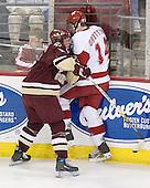 Tim Filangieri 5 of Boston College pins Ben Grotting 14 of the University of Wisconsin to the boards. The Boston College Eagles defeated the University of Wisconsin Badgers 3-0 on Friday, October 27, 2006, at the Kohl Center in Madison, Wisconsin in their first meeting since the 2006 Frozen Four Final which Wisconsin won 2-1 to take the national championship.<br />