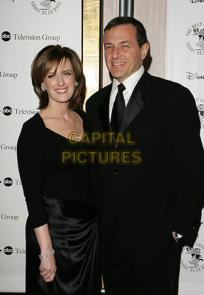 ANNA SWEENEY & ROBERT IGER.The Help Teddy Bear Ball held at the Beverly Hilton Hotel, Beverly Hills, California..December 3rd, 2005.Photo: William Scott/AdMedia/Capital Pictures.Ref: WS/ADM.half length black suit jacket.www.capitalpictures.com.sales@capitalpictures.com.© Capital Pictures.
