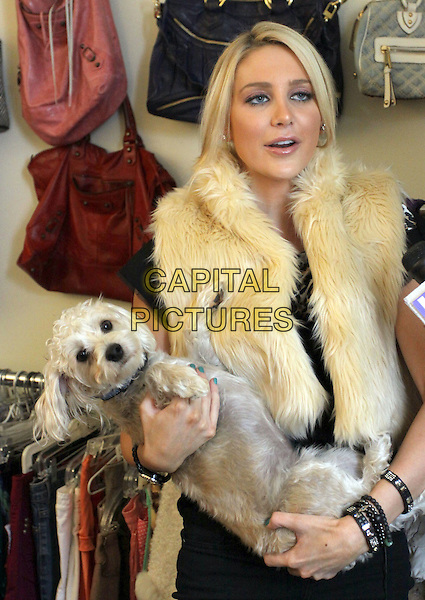 "STEPHANIE PRATT.Hollyscoop.com Closet Raiders with ""The Hills"" Stephanie Pratt held At A Private Residence, Pacific Palisades, California, USA..September 28th, 2009.half length black top gilet fur carrying dog animal pet bracelets green nail varnish polish .CAP/ADM/KB.©Kevan Brooks/AdMedia/Capital Pictures."