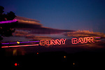 "A neon sign is reflected in the glass door of the Moonlite Bunny Ranch brothel in Mound House, NV on Friday, July 28, 2006...The Moonlite Bunny Ranch brothel in Mound House, Nevada - just a few miles from the state capital in Carson City - first opened in 1955. The Ranch is a legal, licensed brothel owned by Dennis Hof. It's featured in the HBO series ""Cathouse."""