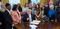 United States President Donald. J. Trump prepares to sign H.R. 1865, the &quot;Allow States and Victims to Fight Online Sex Trafficking Act of 2017&quot; at The White House in Washington, DC, April 11, 2018. With Trump are victims and family members of victims of online sex trafficking and members of Congress who helped pass the bill. <br /> CAP/MPI/CNP/RS<br /> &copy;RS/CNP/MPI/Capital Pictures