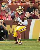Washington Redskins quarterback Robert Griffin III (10) looks to pass in second quarter action against the Detroit Lions at FedEx Field in Landover, Maryland on Thursday, August 20, 2015.<br /> Credit: Ron Sachs / CNP