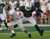 Richard Sanders (2), West Bloomfield, attempts to wrap up Clarkston wide receiver Keagan King, during varsity football action at West Bloomfield High School Friday, Sept. 15, 2017. West Bloomfield dominated the Wolves throughout the game for a 37-15 victory. Photos: Larry McKee, L McKee Photography. PLEASE NOTE: ALL PHOTOS ARE CUSTOM CROPPED. BEFORE PURCHASING AN IMAGE, PLEASE CHOOSE PROPER PRINT FORMAT TO BEST FIT IMAGE DIMENSIONS. L McKee Photography, Clarkston, Michigan. L McKee Photography, Specializing in Action Sports, Senior Portrait and Multi-Media Photography. Other L McKee Photography services include business profile, commercial, event, editorial, newspaper and magazine photography. Oakland Press Photographer. North Oakland Sports Chief Photographer. L McKee Photography, serving Oakland County, Genesee County, Livingston County and Wayne County, Michigan. L McKee Photography, specializing in high school varsity action sports and senior portrait photography.