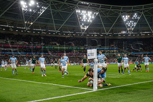30.10.2015. Olympic Stadium, London, England. Rugby World Cup Bronze Final. Argentina versus South Africa. South Africa second row Eben Etzebeth powers over to score his side's second try despite the tackle of Argentina loosehead prop Juan Figallo
