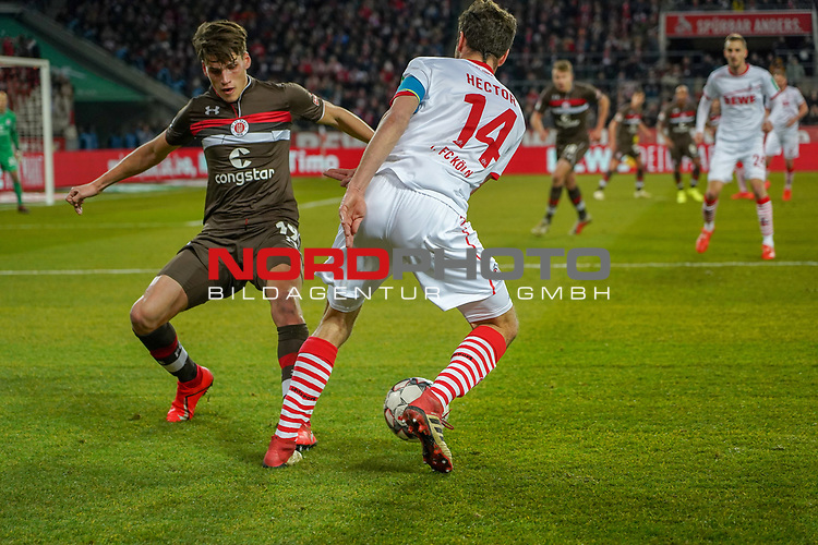 08.02.2019, RheinEnergieStadion, Koeln, GER, 2. FBL, 1.FC Koeln vs. FC St. Pauli,<br />  <br /> DFL regulations prohibit any use of photographs as image sequences and/or quasi-video<br /> <br /> im Bild / picture shows: <br /> Jonas Hector (FC Koeln #14),  im Zweikampf gegen  Luca Zander (St Pauli #19), <br /> <br /> Foto &copy; nordphoto / Meuter