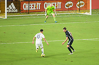 CARSON, CA - SEPTEMBER 15: Cristian Pavon #10 of the Los Angeles Galaxy attempts to moves past Graham Smith #16 of Sporting Kansas City during a game between Sporting Kansas City and Los Angeles Galaxy at Dignity Health Sports Complex on September 15, 2019 in Carson, California.