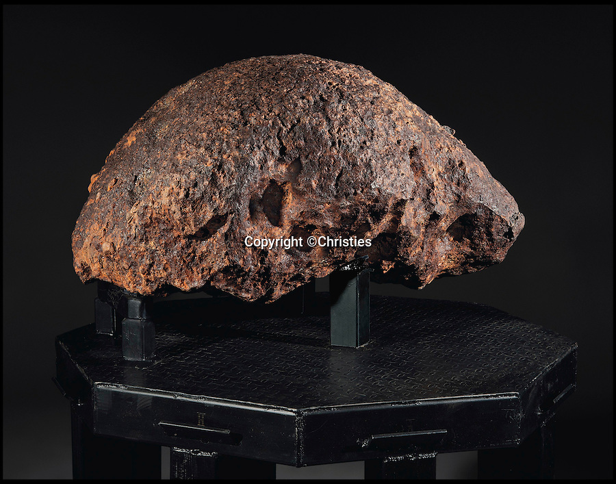 BNPS.co.uk (01202 558833)<br /> Pic: Christies/BNPS<br /> <br /> The world's largest oriented meteorite estimate £800,000.<br /> <br /> An out of this world collection of meteorites gathered from across the globe is set to go under the hammer for an astronomical £3.4million.<br /> <br /> Amongst the 83 rocks is the only meteoroid that has killed and a chunk of the fireball which tore through the skies of Russia in 2013 hospitalising 112 people. <br /> <br /> Despite the violence of their atmospheric entry some have a natural beauty with dramatic jewel-like slices, sitting beside scorched chunks of iron and stone.