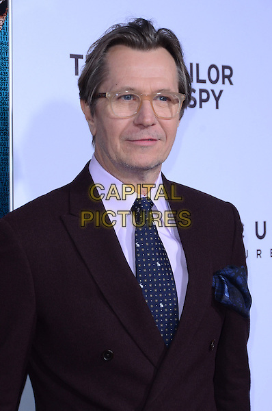 Gary Oldman.The premiere of Focus Features' 'Tinker, Tailor, Soldier, Spy' held at Arclight Cinema's Cinerama Dome, Los Angeles, California, USA..December 6th, 2011.headshot portrait blue tie brown maroon burgundy jacket suit purple shirt glasses .CAP/ADM/TW.©Tonya Wise/AdMedia/Capital Pictures.