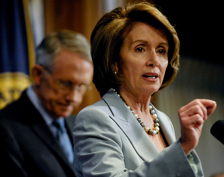 WASHINGTON, DC - Jan. 25: House Speaker Nancy Pelosi, D-Calif., speaks at the National Press Club in anticipation of President Bush's Jan. 28 State of the Union address to a joint session of Congress. She and Senate Majority Leader Harry Reid, D-Nev., left, outlined a legislative agenda that challenges President Bush and other Republicans on a broad front. She called for sweeping global warming legislation, major health care initiatives, and large infrastructure investments. Reid called on Bush to use his State of the Union address Monday night to state explicitly that no arm of the federal government will engage in any form of torture, including the controversial simulated drowning technique known as waterboarding. Reid also said Bush should announce the shutdown of the prison for terrorism suspects at Guantanamo Bay in Cuba and chart a drawdown of U.S. troops in Iraq. (Photo by Scott J. Ferrell/Congressional Quarterly)