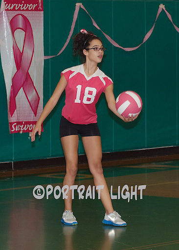 Clinton High junior Ariam Solivan serves the ball on Pink Night.