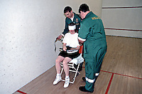Paramedic ambulance crew attending a victim of a sports injury who was hit in the face with a racket whilst playing squash. This image may only be used to portray the subject in a positive manner..©shoutpictures.com..john@shoutpictures.com