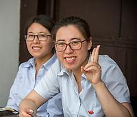 Suzhou, Jiangsu, China.  Young Chinese Women Posing for Photo.