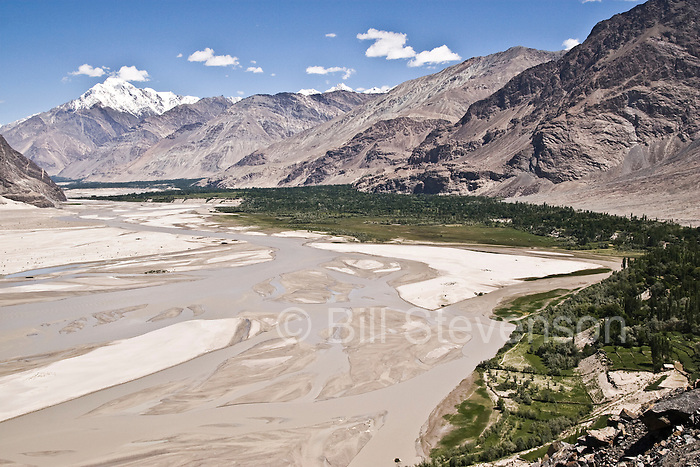 The Braldu river flowing through the Shigar Valley below snow capped mountains in the Karakoram himalaya of Pakistan