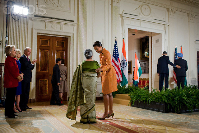 24 Nov 2009, Washington, DC, USA --- First lady Michelle Obama with Prime Minister of India Manmohan Singh's wife, Gursharan Kaur during a welcoming ceremony at the White House in Washington.  On the right are President Barack Obama and India's Prime Minister Manmohan Singh. --- Image by © Brooks Kraft/Corbis