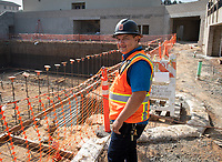 Greg Ochoa, Senior Project Manager, Facilities Management Department, Occidental College<br /> Concrete is poured for the first time in the new De Mandel Aquatic Center.<br /> Occidental's new 58,000 square-foot complex will make it possible for Oxy's swimming, diving, water polo and tennis teams to train and compete in facilities that meet NCAA and conference standards.<br /> Photographed April 26, 2019.<br /> (Photo by Marc Campos, Occidental College Photographer)