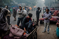 OLD DELHI, INDIA, JANUARY 11, 2016: A man wakes-up on the street at a sleep market where he rented a blanket on January 11, 2016 in Old Delhi, India. <br /> Daniel Berehulak for The New York Times
