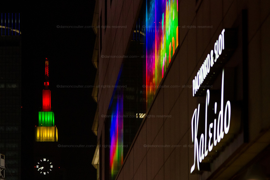 The NTT Docomo Tower lit up in rainbow colours from Shinjuku, Tokyo, Japan. Saturday August 24th 2019