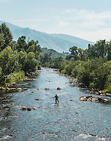 Fly fisherman and water tubers in the Yampa River in Steamboat Springs, Colorado, Saturday, August 22, 2015.<br /> <br /> Photo by Matt Nager