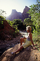 Woman by the river in Zion National Park, Utah, USA