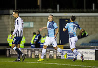 Garry Thompson of Wycombe Wanderers celebrates with Scott Kashket the third goal his second during the Checkatrade Trophy round two Southern Section match between Millwall and Wycombe Wanderers at The Den, London, England on the 7th December 2016. Photo by Liam McAvoy.