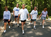 United States President George W. Bush and First Lady Laura Bush complete a four mile walk with brother Marvin Bush, left, Chief of Staff Andy Card and wife Kathleene after undergoing a colorectal screening procedure at Camp David, the presidential retreat near Thurmont, Maryland, Saturday morning, June 29, 2002.  <br /> Mandatory Credit: Eric Draper / White House via CNP