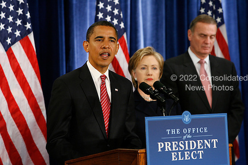 Chicago, IL - December 1, 2008 -- United States President-elect Barack Obama gives a press conference to introduce nominees United States Senator Hillary Rodham Clinton (Democrat of New York),middle, for Secretary of State,  and retired Marine General James L. Jones, right, as national security adviser at the Chicago Hilton & Towers Monday morning, December 1, 2008.  Obama also nominated Washington Lawyer Eric Holder, for Attorney General, Arizona Gov. Janet Napolitano, for homeland security and Susan Rice as United Nations Ambassador. Obama said he would keep defense secretary Robert Gates in his current post.  .Credit: Anne Ryan - Pool via CNP