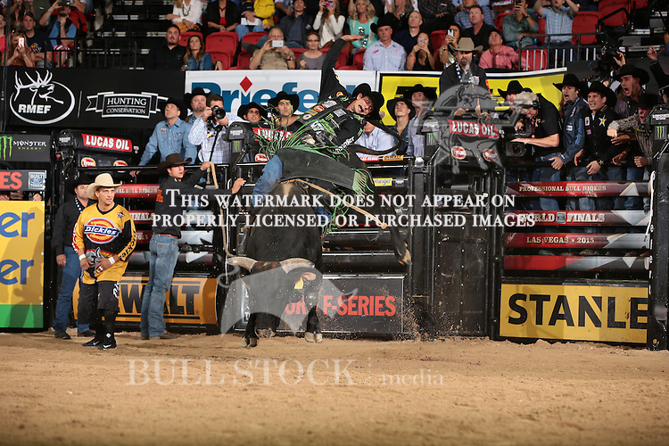 JB Mauney rides Diamond S's Wicked Stick for 91 points during the first round of the World Finals Built Ford Tough Series PBR. Photo by Andy Watson