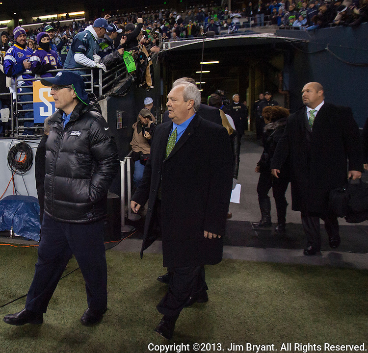 Seattle Seahawks team owner Paul Allen (L0 walks out onto the field before their game against the New Orleans Saints at CenturyLink Field in Seattle, Washington on December 2, 2013. The Seahawks beat the Saints 34-7 to take the best record team in the NFL.©2013. Jim Bryant Photo. ALL RIGHTS RESERVED.