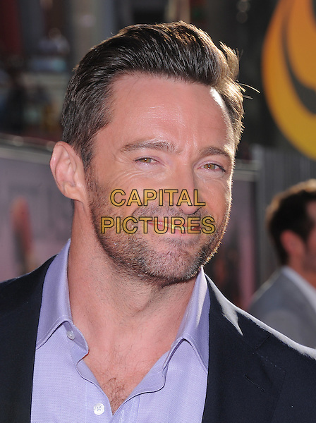 Hugh Jackman.The L.A. Premiere of 'Real Steel' held at Universal CityWalk in Universal City, California, USA..October 2nd, 2011 .headshot portrait  black suit jacket purple shirt stubble facial hair  .CAP/RKE/DVS.©DVS/RockinExposures/Capital Pictures.